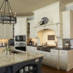 The idea of antique white kitchen cabinets with dark island will bring you back to an old grandmother's house vibe. Most tends to use earth-tone color. Traditional Kitchen Design, Home, New Kitchen, Colonial Kitchen, White Kitchen Traditional, Home Kitchens, Traditional Kitchen, Ivory Cabinets, Kitchen Design