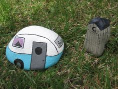 camper and outhouse painted rocks by Gina Dewan
