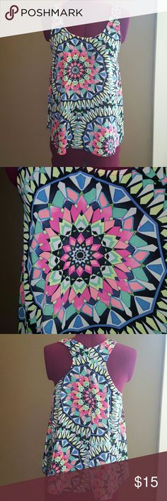 Geometric flowy tank top These vibrant colors are perfect for summer and with its breathable material it'll keep you cool as well. *material is sheer so I suggest wearing a bandeau or cami underneath. 100% polyester Tops