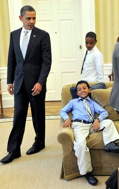 "Love this photo!! WASHINGTON - OCTOBER 11: ( AFP OUT) U.S. President Barack Obama looks at Francisco, a first grade student from Bronx, New York, one of the students from the movie ""Waiting for Superman"" who is making himself comfortable on a sofa in the Oval Office of the White House on October 11, 2010 in Washington, DC. The children toured the White House and met with Obama. (Photo by Ron Sach-Pool/Getty Images) 2009 Getty Images"