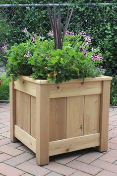 Cedar Planter Hand crafted from natural cedar this planter has an opening for inserting a medium sized flower pot. There are 2 positions to hold the pot at the … Diy Wooden Planters, Outdoor Planter Boxes, Cedar Planter Box, Diy Planter Box, Outdoor Planters, Square Planter Boxes, Outdoor Flower Boxes, Planter Ideas, Porch Wooden