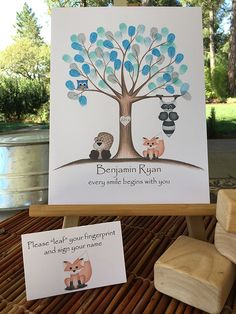 Customizable woodland animal fingerprint tree guestbook for a woodland animal themed baby shower, featuring a blue owl, fox, beaver, and raccoon.