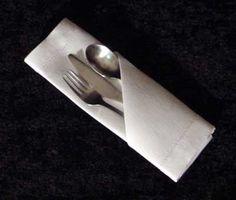 Folding napkins for silverware