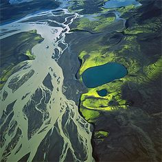 Veidivötn is a watery landscape in central Iceland on the northwest edge of the Vatnajoküll Glacier, flown through by many meltwater streams. It contains some 50 lakes, many of them in craters caused by Veidivötn's position above a volcanic fissure zone