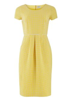 Elegant shift dress in yellow, hand woven textured fabric. Short sleeves with front pockets and fully lined. Made with 100% cotton.