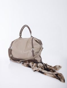 Hand and shoulder bag decorated with buckles
