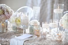 i love the sequin tablecloth cover as well as the vases with flowers and candles. very simple, chic and glamarous. //Photography by ykvision.com, Styling, Tablescape, Floral   Event Design by zestfloral.com, Invitation Design   Engraved Perspex Design Details by astridmuellerexclusive.com