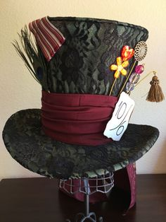 Youre all late for tea! With this Mad Hatter Hat, youll look just like Tarrant Hightopp! This top hat is inspired by Tim Burtons Alice in Wonderland Mad Hatter! In the movie, the Mad Hatter is played by Johnny Depp! And who wouldnt want to look like Johnny Depp?! The hat has about 22 1/2 inches, or 57 centimeters, in circumference. Its very high quality, and perfect for completing a costume or just to play with! The hat includes the Mad Hatters signature price card: 10/6, which means 10…