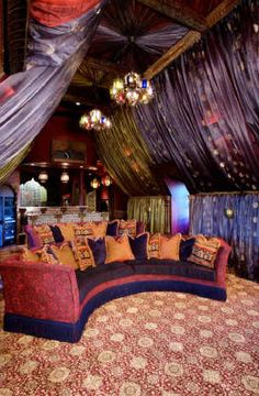 Exotic draped home theater...a little tacky? Maybe. Awesome? Yes if I were uber rich