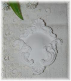klein ornamentje van gips.
