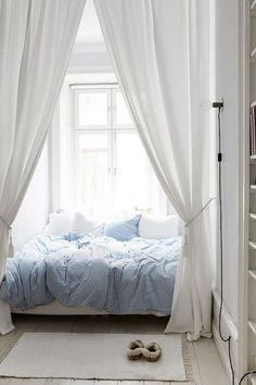 Bright Scandinavian bedroom with modern interior in white and blue.
