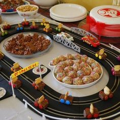 Awesome race track centre piece Racing cars are a milky way bar, a tiny teddy and 4 smarties.