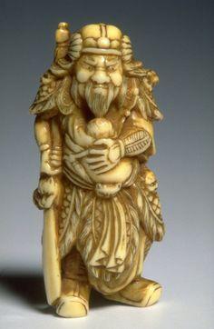 Babywearing Chinese Warrior. Real men wear babies. 19th century carved Japanese ivory netsuke