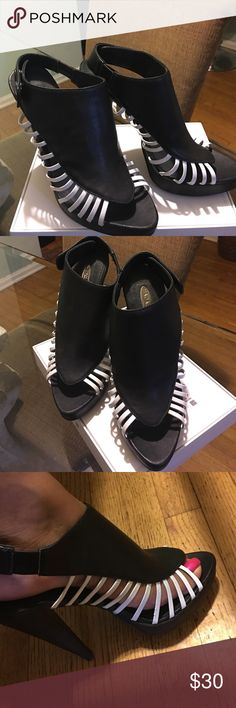 New Size 9 Unknown Designer  Platform heels Black and White Platform heels Size 9. These are about 4 inches tall heels. Even though they are size 9, they fit size 8 perfectly. Shoes are almost new, the brand is Hadari. Shoes Heels