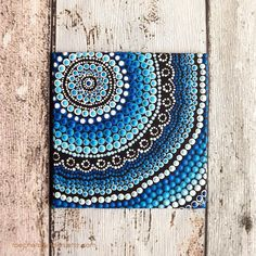 """Original painting with concentric circle pattern which represents """"meeting place"""" in Aboriginal art. By Biripi artist, @Raechel Saunders"""