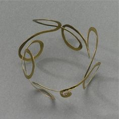 Bracelet | Alexander Calder, Untitled, hammered brass, 2 by 3 by 3 in. 5.1 by 7.6 by 7.6 cm.
