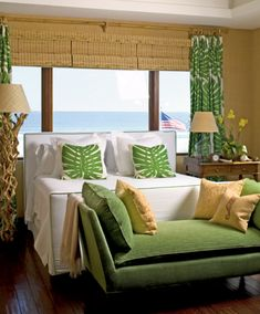 island decorating with green wihte and beige, tan, straw and natural window shades