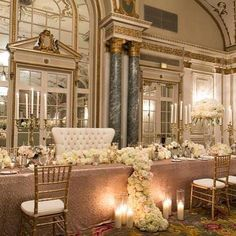 For ultimate elegance and sophistication decorate your head table with gold candelabras and let lush floral arrangements flow over into pillar candles.  #touchofwhimsy #letsgetwhimsical #weddings #weddingplanner #weddingcoordinator #eventplanner #eventcoordinator #weddingtrends #bride #groom #bridal #weddingdecor #weddingvenue #weddingdesign #weddingreception