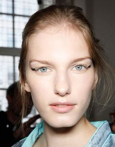 Spring 2012 runways: Modernized cat-eyes leave the lines to the artist's discretion. Fresh nude faces are the perfect canvas.
