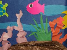 cut-outs for along hallway walls: fish, turtle, different colored blue paper, seaweed, brown paper, etc.