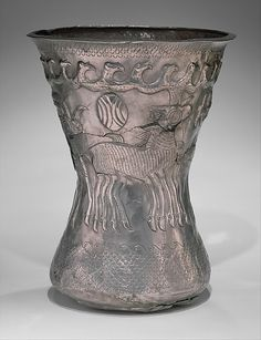 Beaker with birds and animals  Date:     ca. 4th century B.C. Geography:     Thrace Medium:     Silver Dimensions:     H. 18.7 cm Classification:     Metalwork