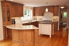 shape of kitchen and counters work well with a door to bathroom/utility behind kitchen