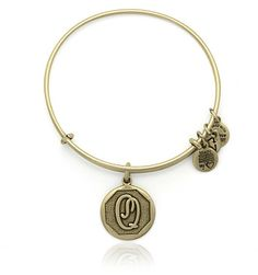 Personalize your jewelry with initials! Choose your own or give a personal gift to someone you love. Each charm is beautifully stamped with script letters creating an elegant and classic look. Each charm hangs from Alex and Ani's Expandable Wire Bangle and is available in a Russian Gold and a Russian Silver finish.