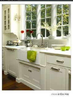 i love a cute farmhouse sink in a kitchen, this is also so simplistically gorgeous.