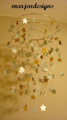 silver gold shimmery star mobile, dorm room decor, photo prop, crib mobile, teen room decor, outer space theme, galaxy, twinkle twinkle by marjendesigns on Etsy https://www.etsy.com/listing/168543305/silver-gold-shimmery-star-mobile-dorm