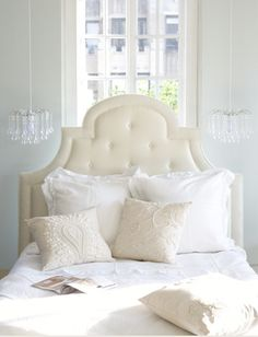 OMG! I love this room! Simplicity at its best!     Recognize the teardrop chandelier? LOVE! Tufted upholstered off-white cream tufted headboard bed, tear drop crystal glass chandeliers and textured linen throw pillows! Soft blue gray bedroom, soft blue gray paint wall color. Cream white tan blue gray bedroom space colors.