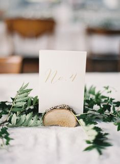 log place card holder and vine centerpiece More