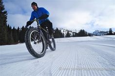 Andy Williams on a fat bike on a groomed trail