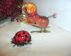 2 VINTAGE TIN WIND UP TOYS, DOG WITH FLOPPY ARMS/EARS, LADY BUG HONG KONG
