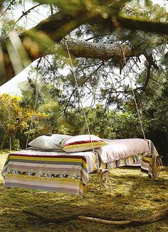 Who doesn't love a swinging bed? Hope the tree is sturdy! lol