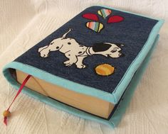 https://www.etsy.com/listing/188451801/dog-applique-book-cover-on-jeans-book?ref=related-1