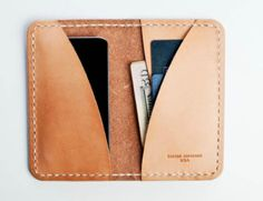 A man's wallet doesn't have to be a square box on his pocket. keep a little cash, couple good cards and couple business cards.