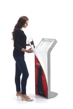 AURA by Armodilo | Tablet Kiosk with magnetic & removable back-lit graphic panels -- magnetic graphic panel being removed