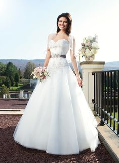 Sincerity wedding dress style 3756 This circular cut tulle skirt has a sweetheart neckline with beaded lace  and pleated tulle. The basque waistline also has beaded lace. The back  of this gown has tulle buttons that cover the zipper and ends with a  chapel length train. Gown comes with a detachable gray beaded velvet  belt.