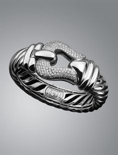 David Yurman- SILVER ICE -web-May.2013,USD 5450, •From the Cable Buckle Collection™.  •Sterling silver.  •Pavé diamonds; 2.47 total carat weight.   •15mm.   •Standard medium wrist size.