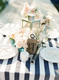 Table decor ideas. Lantern as a centerpiece. Fill with lavender, anemones, thistle, eucalyptus. Vintage bottles around, gray linene under.