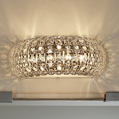 """Bejeweled in crystals over gleaming chrome, this bath light glitters with the unmistakable radiance of rare diamonds. 3x40 watts T4 G9 120v Xenon bulbs included. (5.25""""Hx13""""Wx7""""D). Backplate (5.25""""Hx13""""W)."""