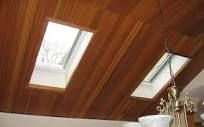 A skylight window, also called a roof window, brings natural daylight into a room and helps reduce energy bills by providing illumination during the day without turning on the lights. Wood Windows, Windows And Doors, Brighten Dark Hallway, American Roofing, Modern Skylights, Skylight Window, Wood Ceilings, Wood Trim, Home Renovation