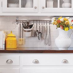Put kitchen utensils within easy reach by hanging them from a modular utility rail mounted on the backsplash. IKEA and ClosetMaid both carry affordably priced selections. Kitchen Utensil Organization, Kitchen Utensils, Kitchen Gadgets, Home Organization, Kitchen Storage, Cooking Utensils, Organization Station, Kitchen Counters, New Kitchen