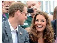 215a The picture is framed in a way that Prince William is looking at Kate, Kate is smiling looking in the direction of the camera so the focus is her smiling face.