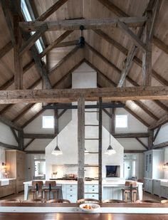 Old barn converted into a home! The second story hay loft was removed, but kept the original ladder for aesthetics!  Walls painted white to help showcase the wood beams and brighten up the living space.