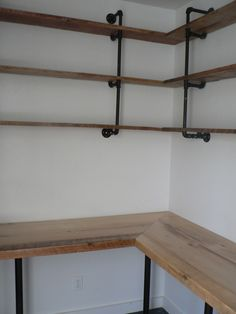 Closet turned into office using reclaimed wood and pipes