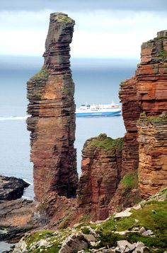 The Old Man of Hoy - a famous 450 foot sea stack which is Orkney's most famous landmark.  Allow 3 hours for the round trip walk from Rackwick Bay to the Old Man of Hoy.  Please note the walk is a rough track and is very demanding.  You can see in the background the daily ferry service from Scrabster to Stromness, Orkney Islands, Scotland.