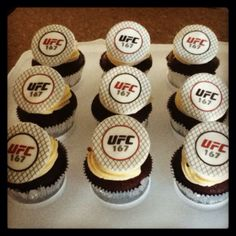 UFC Cupcakes. I made the toppers using edible ink transfers on top of rolled fondant. The cupcake themselves are Guiness chocolate cake, filled with chocolate and Jameson ganache and then topped with a Baileys flavored swiss buttercream.