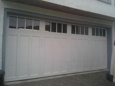 Double Wide Clopay Coachman Garage Door In White.