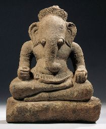 a khmer, angkor vat style, sandstone figure of ganesha 12th century Seated in virasana on a rectangular base, both hands resting on his knees and holding reddish and bowl, wearing striated sampot with flange curling over the plain belt, the reverse with butter-fly shaped element, pot-bellied, trunk and short tusks, his face with eyes, large ears and crown set on top of his head 37 cm high